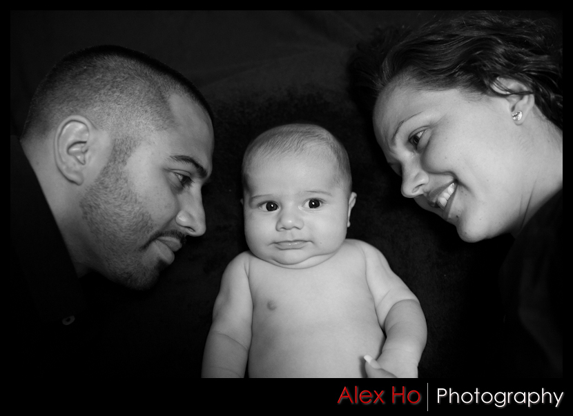 mom dad baby black white photo