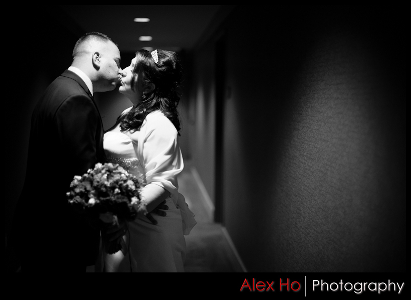kiss bride groom hallway hotel napa