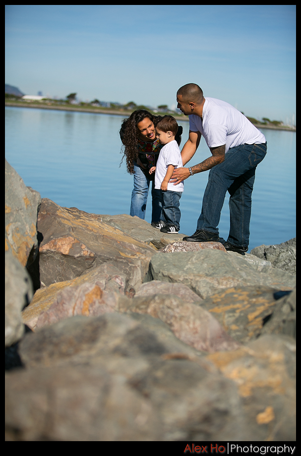 family enjoying waterfront rocks