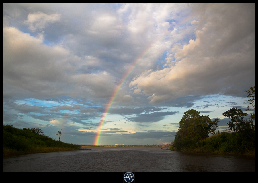 amazon jungle river boat rainbow